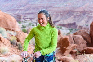 Jasmin Caton climing sandstone, cracks in Longs Canyon, outside Moab, Utah
